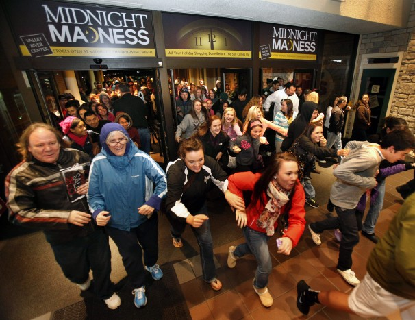 Crowd rushing into a store at midnight on black friday